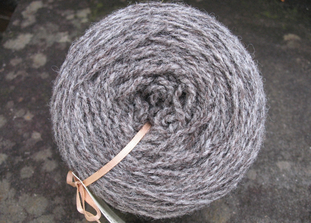 The undyed yarn is  in a blend of white and dark brown fleece in a 1 to 1 ratio.
