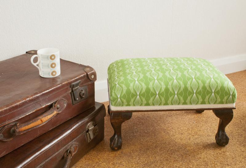 Annabel Perrin, mid-century footstool, green geometric print, ottoman, graphic pattern