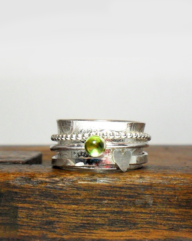 peridot and silver spinner ring