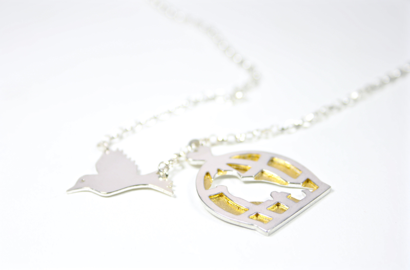 flying bird necklace, birdcage necklace, fox and fables jewellery, studio jewellery,