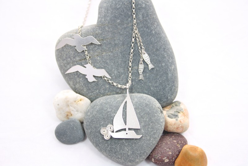 silver boat necklace, sailing boat charm necklace, foxes and fables jewellery, amy prout, studio jewellery, Welsh jeweller, handmade jewellery, elegant sterling silver jewellery, jewellery inspired by Welsh countryside, meet the maker, meet the maker interview