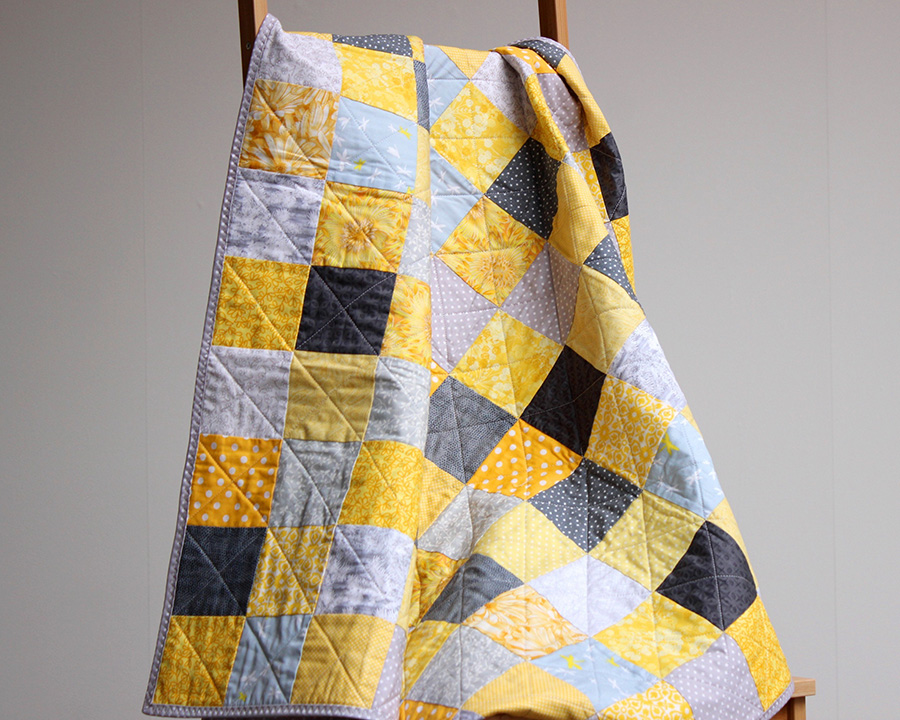 yellow patchwork quilt, patchwork quilt uk, quilt maker, coralie green, contemporary patchwork quilt, geometric patchwork quilt, modern quilt, quilting, quilts, meet the maker,