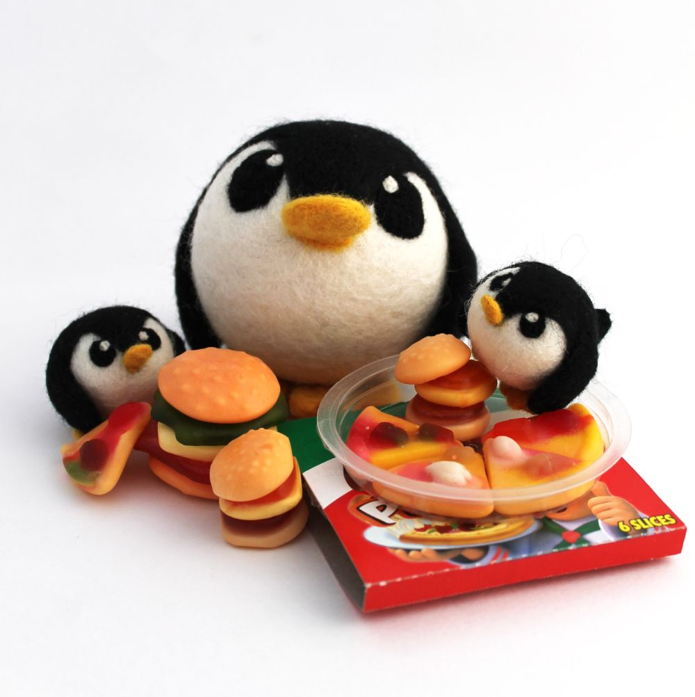 Penguins eating pizzas and burgers