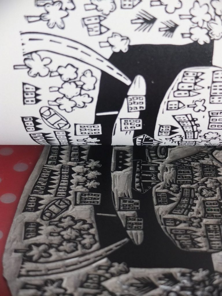 Inked lino print of Bristol being lifted by by Melanie Wickham