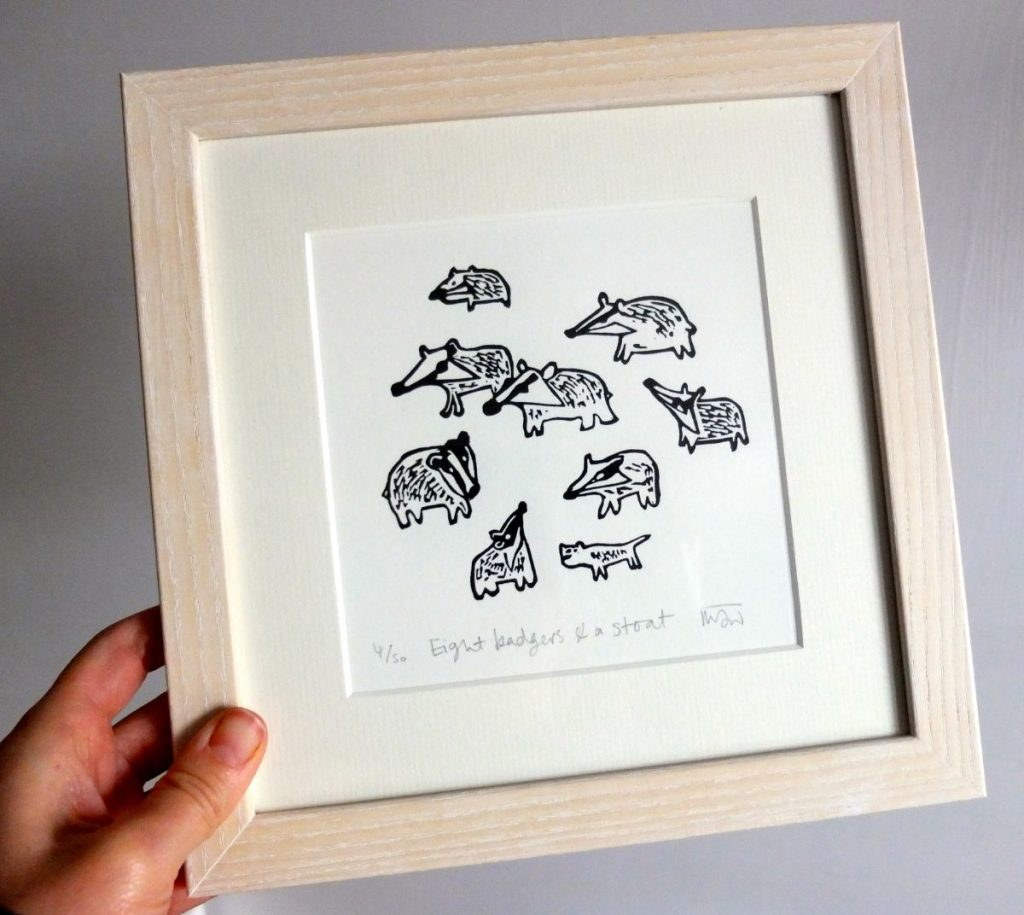 Eight Badgers and a Stoat lino print by Melanie Wickham
