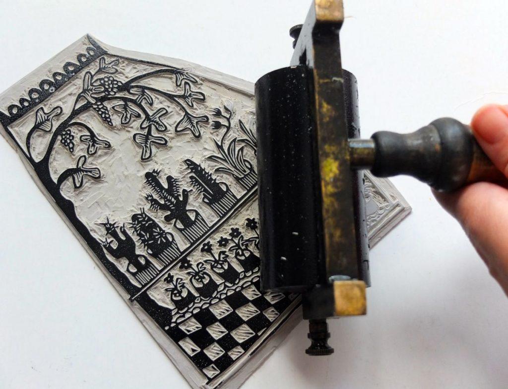 Lino print inking by by Melanie Wickham