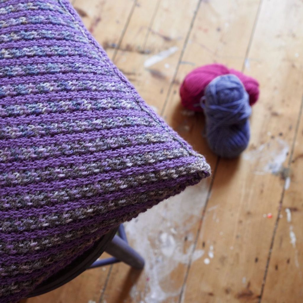 striped purple and grey cushion