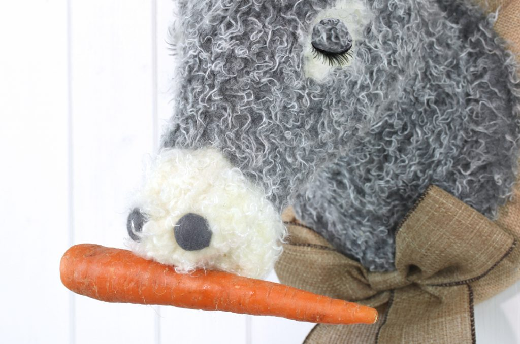 Textile donkey with a carrot