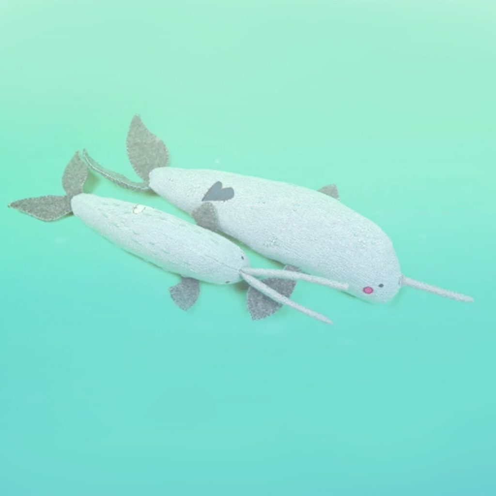 narwhal soft sculptures under water