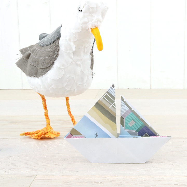 Seagull and an origami sailing boat