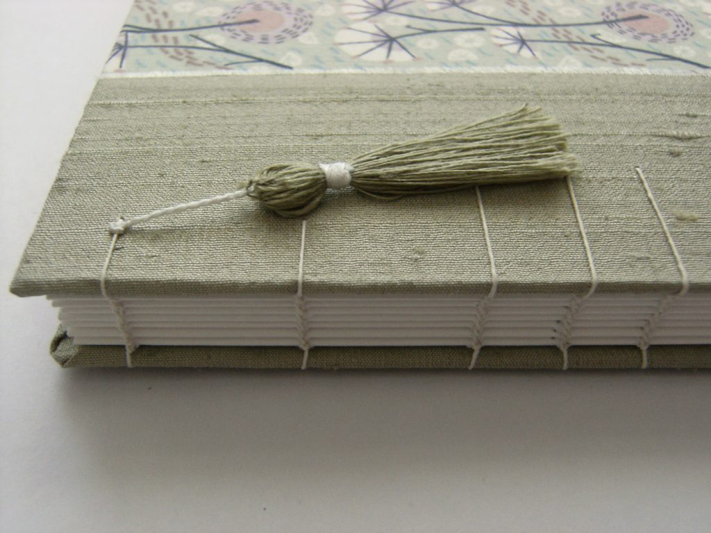 handmade book with tassel