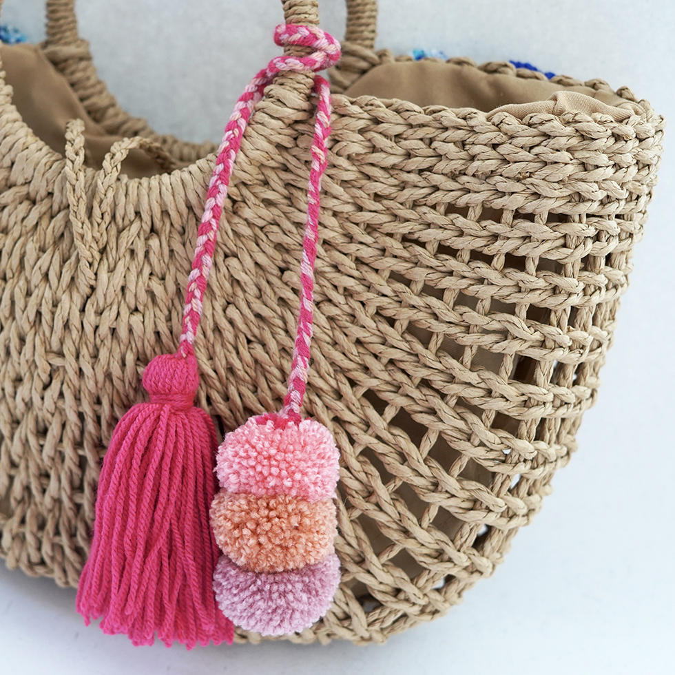 pink tassel and pom pom bag charms