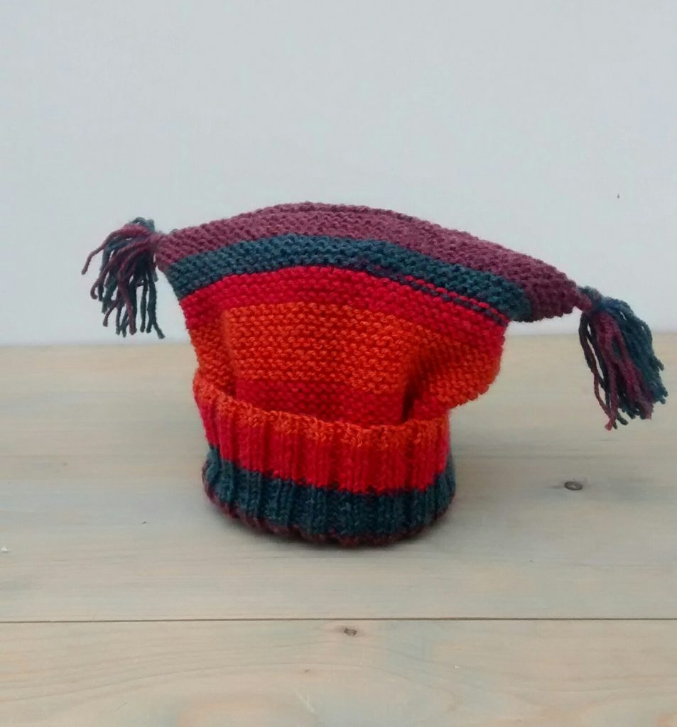 knitted toddler hat with tassels