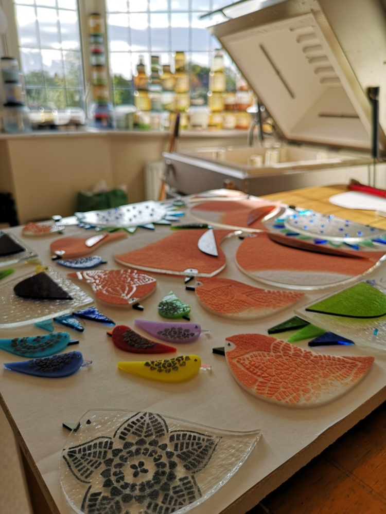 Robyn Coetzee making fused glass bird