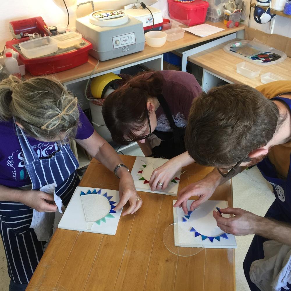 participants at glass workshop making hedgehogs