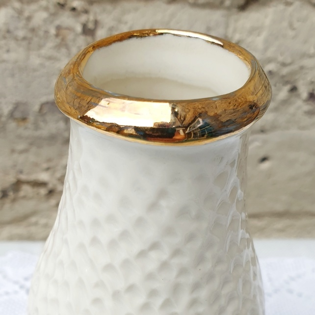 Gold topped porcelain vase