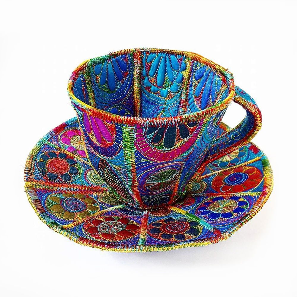 embroidered teacup and saucer Sue Trevor