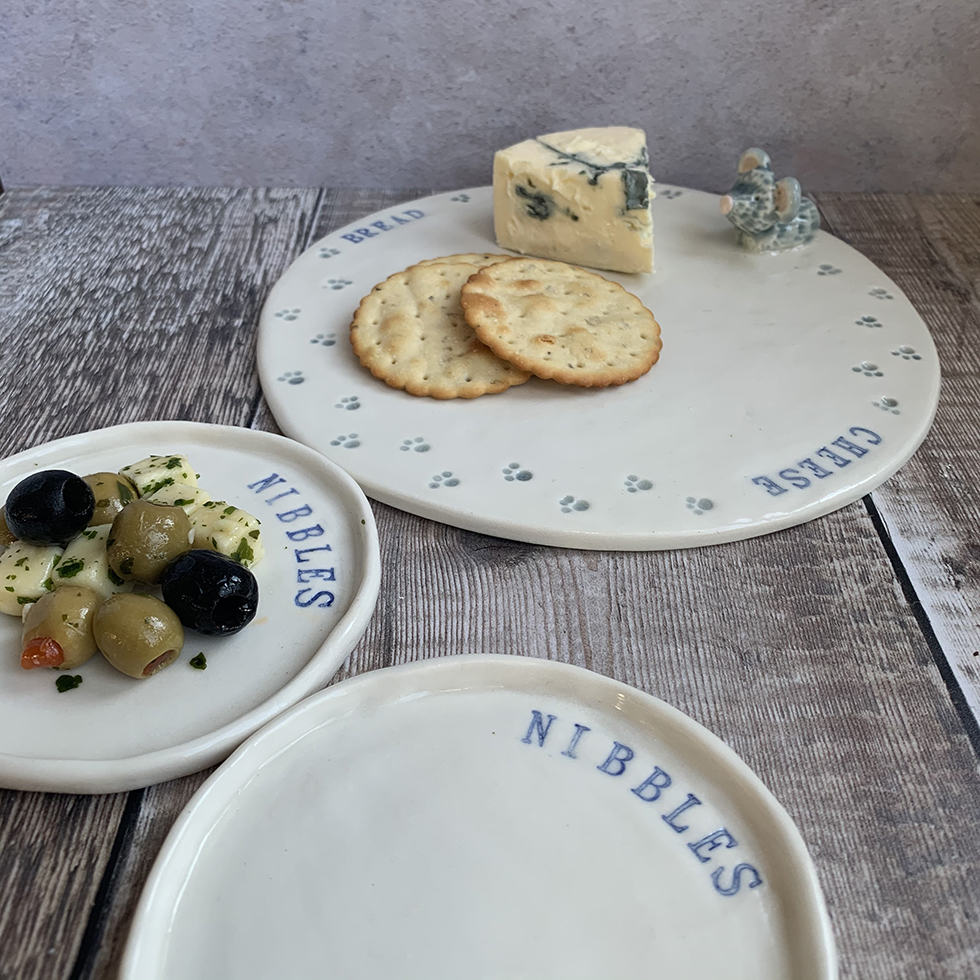 handmade porcelain cheese and nibble plates by Shelly Lee