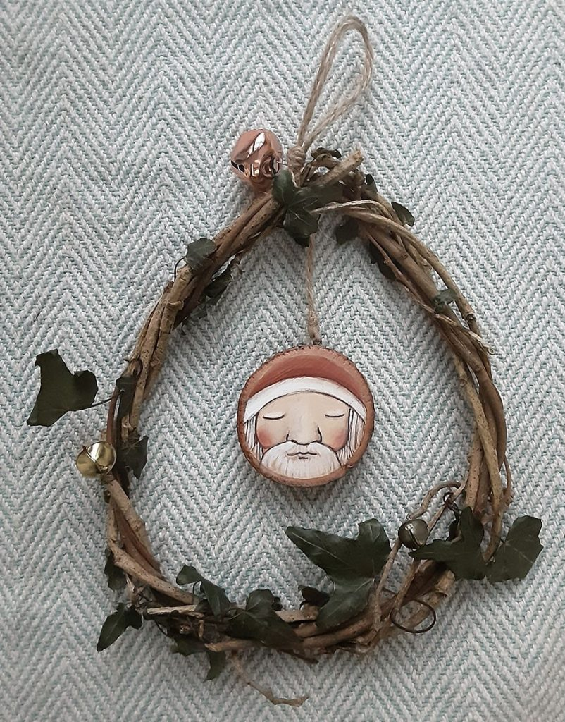 Santa Painted Wooden Round In Wreath by Mooncraft