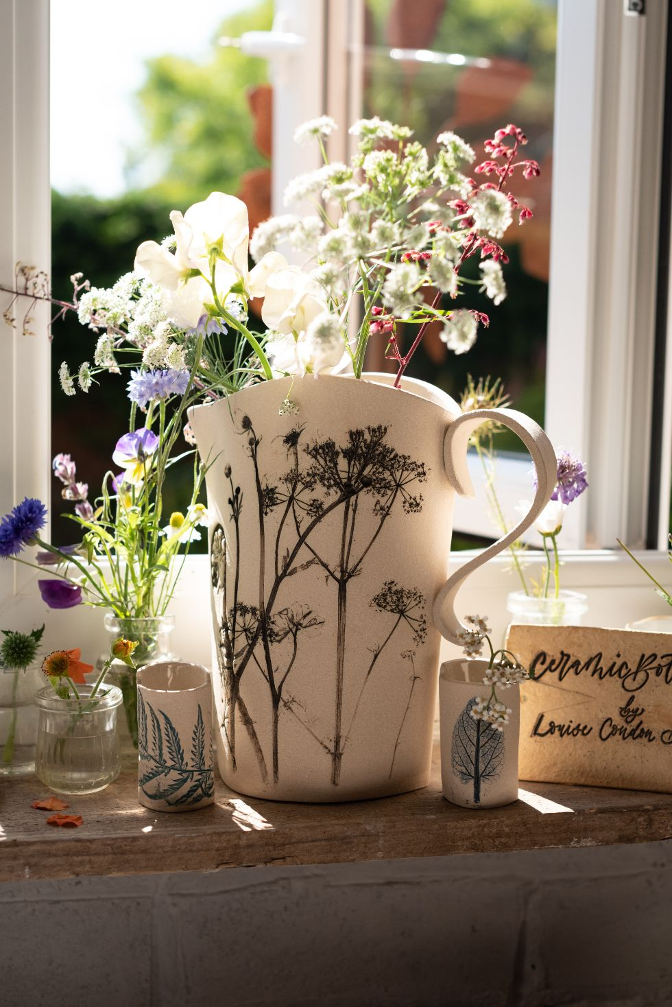 Press flower jug in the window made by Louise Condon, Ceramic Botanist